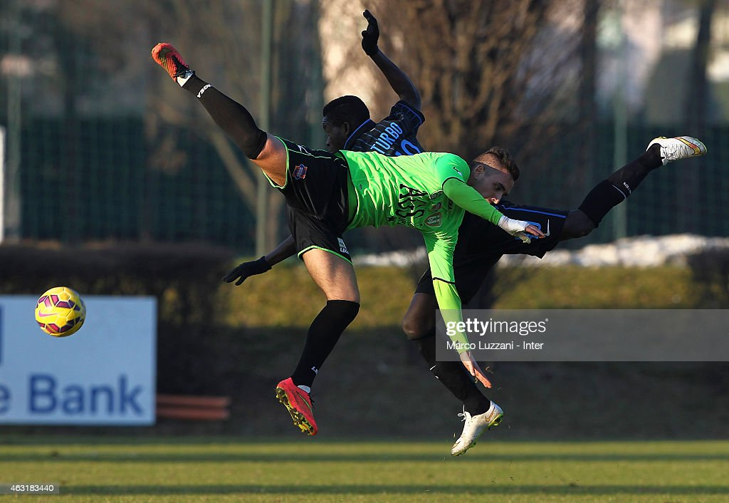 Andrea Mancini (front) competes for the ball withJose Correia (back) of FC Internazionale Milano during FC Internazionale training session at the club's training ground on February 11, 2015 in Como, Italy.