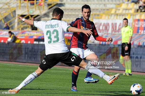 Andrea Mantovani of Bologna FC kicks the ball past Pedro Mendes of US Sassuolo Calcio during the Serie A match between Bologna FC and US Sassuolo...