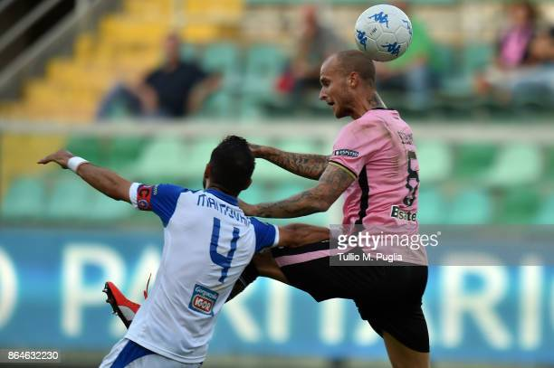 Andrea Mantovani of Novara and Aljaz Struna of Palermo jump for the ball during the Serie B Match Between US Citta' di Palermo and Novara Calcio at...