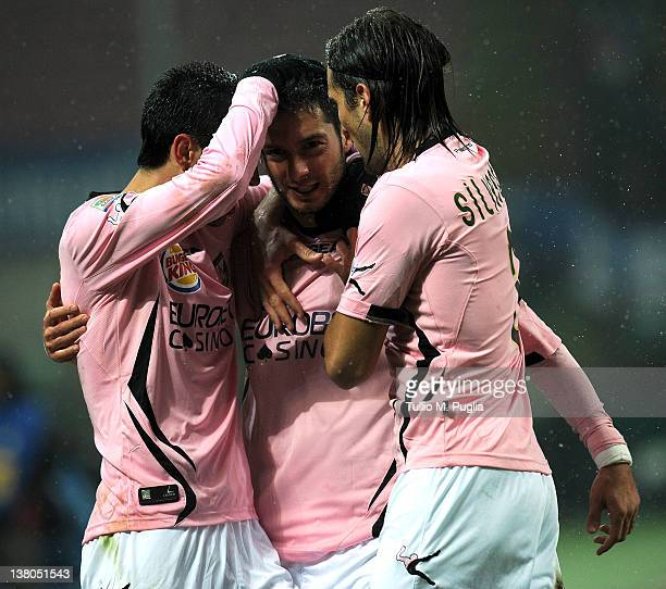 Andrea Mantovani of Palermo celebrates with team mates after scoring the oppening goal during the Serie A match between FC Internazionale Milano and...