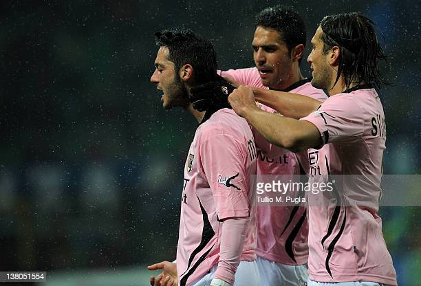 Andrea Mantovani of Palermo celebrates with team mates after scoring the opening goal during the Serie A match between FC Internazionale Milano and...
