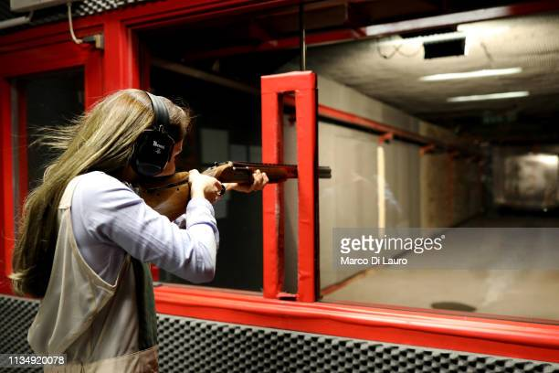 Andrea Maria Neira a 29yearold Spanish client of Perazzi shoots with a shotgun at the shooting range on April 4 2019 at the Perazzi Armi factory in...