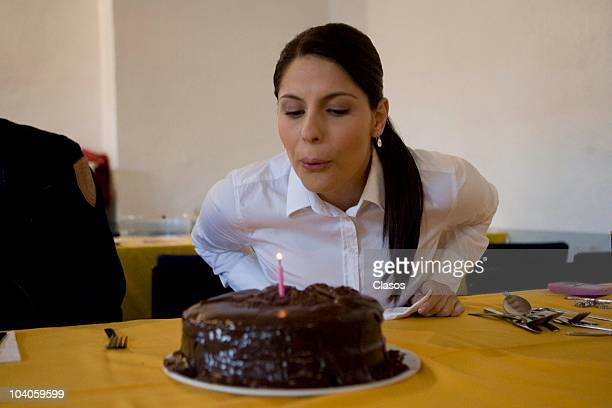 Andrea Marti blows a candle in a cake during the recording of the mexican soap opera Profugas del Amor on September 12 2010 in Real del Monte Mexico