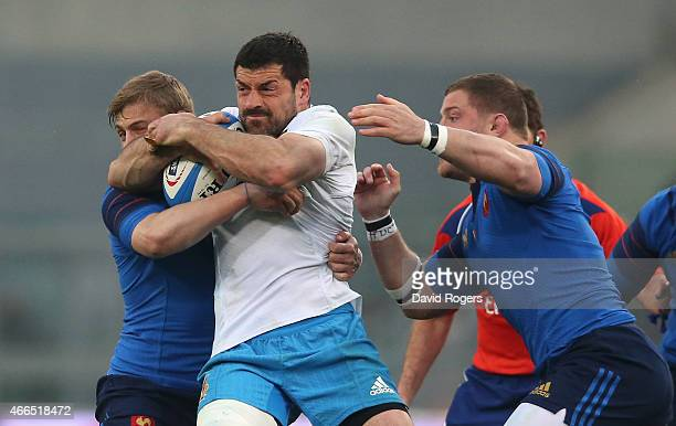 Andrea Masi of Italy is tackled by Jules Plisson and Benjamin Kaiser uring the Six Nations match between Italy and France at the Stadio Olimpico on...