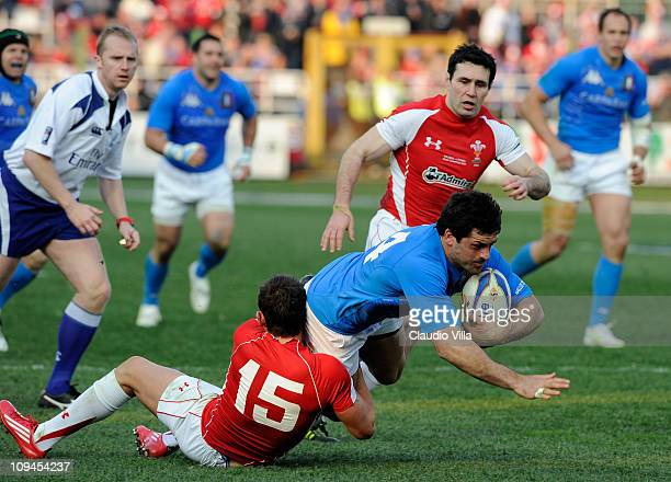 Andrea Masi of Italy is tackled by Lee Byrne of Wales during the RBS Six Nations match between Italy and Wales on February 26 2011 in Rome Italy
