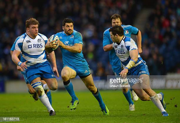 Andrea Masi of Italy is tackled by Sean Lamont of Scotland during the RBS Six Nations match between Scotland and Italy at Murrayfield Stadium on...