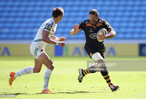 Andrea Masi of Wasps holds off Henry Slade during the Aviva Premiership match between Wasps and Exeter Chiefs at the Ricoh Arena on April 26 2015 in...
