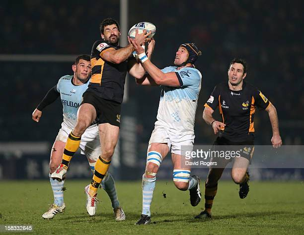 Andrea Masi of Wasps is challenged by Mark Chisholm during the Amlin Challenge Cup match between London Wasps and Bayonne at Adams Park on December...