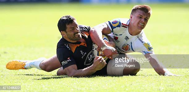 Andrea Masi of Wasps is tackled by Henry Slade during the Aviva Premiership match between Wasps and Exeter Chiefs at the Ricoh Arena on April 26 2015...