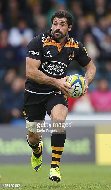 Andrea Masi of Wasps runs with the ball during the Aviva Premiership match between Wasps and Bath at Adams Park on October 12 2014 in High Wycombe...