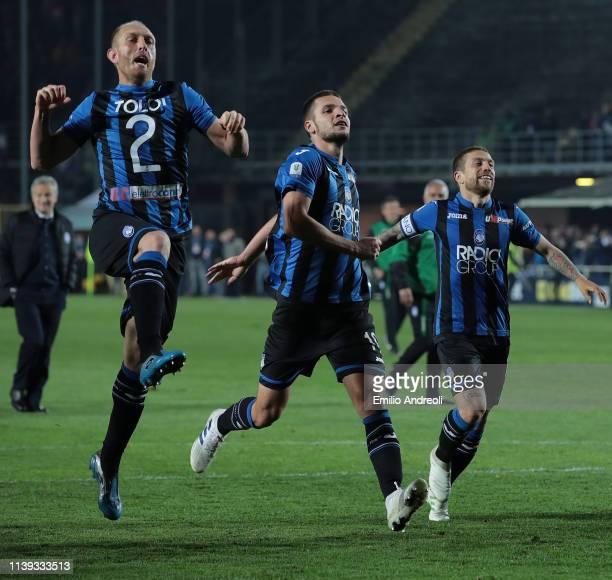 Andrea Masiello Berat Djimsiti and Alejandro Gomez of Atalanta BC celebrate the victory at the end of the TIM Cup match between Atalanta BC and ACF...