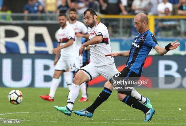 Andrea Masiello of Atalanta BC is challenged by Goran Pandev of Genoa CFC during the serie A match between Atalanta BC and Genoa CFC at Stadio Atleti...