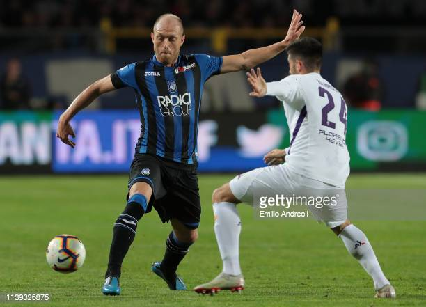 Andrea Masiello of Atalanta BC is challenged by Marco Benassi of ACF Fiorentina during the TIM Cup match between Atalanta BC and ACF Fiorentina at...