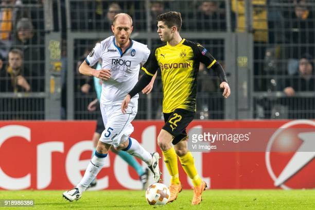 Andrea Masiello of Atalanta Bergamo Christian Pulisic of Borussia Dortmund during the UEFA Europa League round of 32 match between Borussia Dortmund...