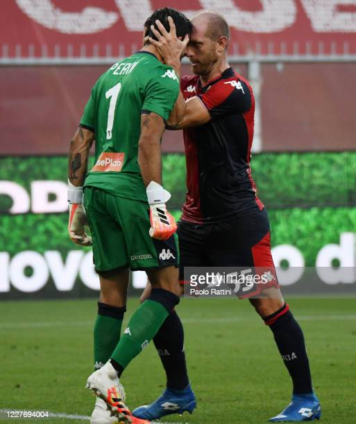 Andrea Masiello of Genoa CFC congratulates the goalkeeper Mattia Perin after his saved penalty during the Serie A match between Genoa CFC and US...