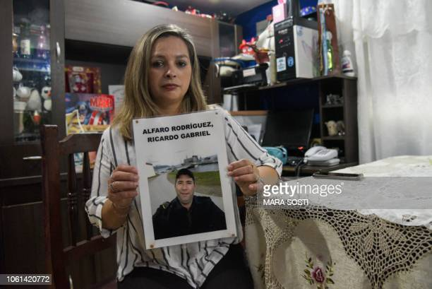 Andrea Mereles wife of Argentine missing noncommissioned officer Ricardo Gabriel Alfaro Rodriguez poses with his picture at her house in Mar del...