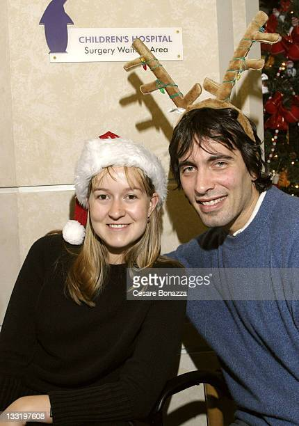 Andrea Meszaros and Carlo Ponti Jr during Carlo Ponti Jr Visits Cancer Patients at Loma Linda Hospital for the 2004 Holiday Season at Loma Linda...