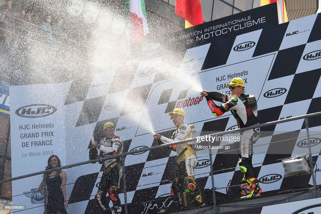 Andrea Migno of Italy and Angel Nieto Team Moto3, Albert Arenas of Spain and Angel Nieto Team Moto3 and Marcos Ramirez of Spain and Bester Capital Dubai celebrate on the podium at the end of the Moto3 race during the MotoGp of France - Race on May 20, 2018 in Le Mans, France.