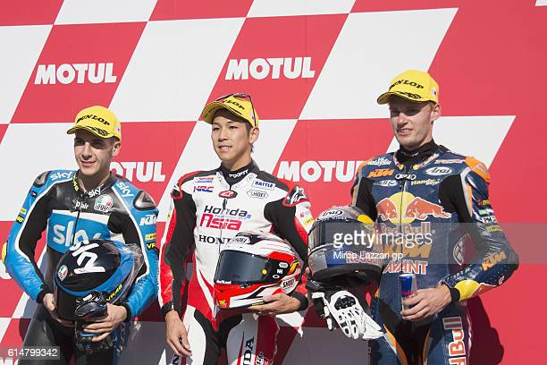 Andrea Migno of Italy and Sky Racing Team VR46 Hiroki Ono of Japan and Honda team Asia and Brad Binder of South Africa and Red Bull KTM Ajo pose at...