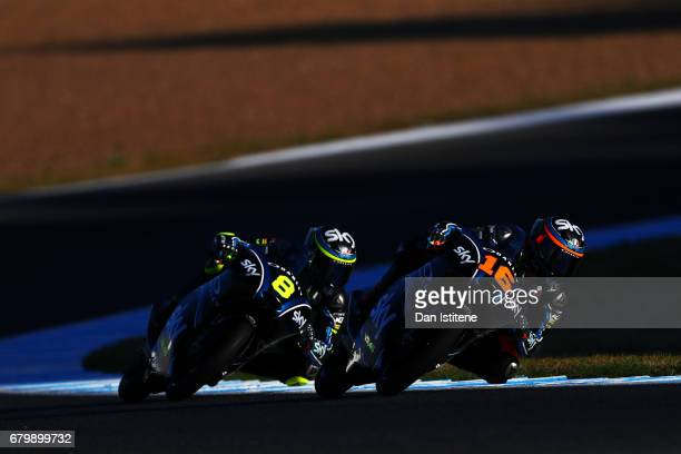 Andrea Migno of Italy and SKY Racing Team VR46 rides ahead of Nicolo Bulega of Italy and SKY Racing Team VR46 during warmup for Moto3 at Circuito de...