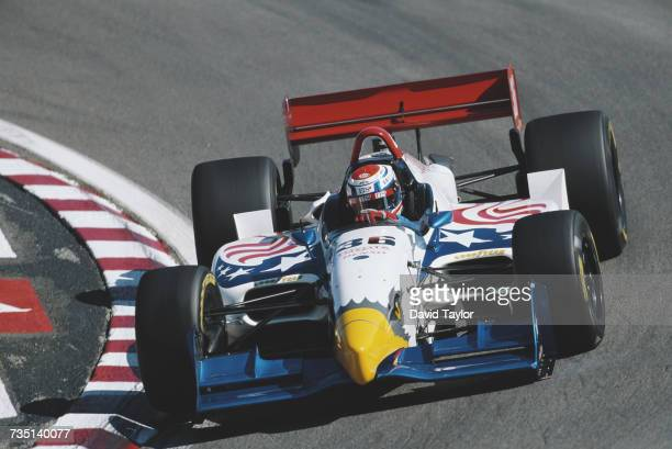 Gualter Salles of Brazil drives the All American Racing Eagle 997 Toyota during practice for the Championship Auto Racing Teams 1999 FedEx...