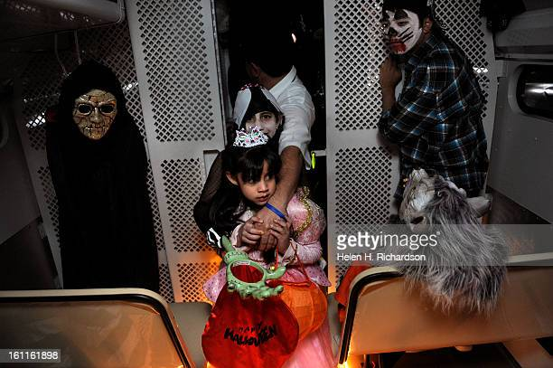 Andrea Moreno is protected by her older sister Patricia 9 and father Cristobal while they come through the haunted police bus The Denver Police...
