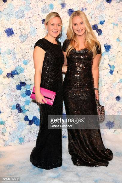 Andrea Muehlbauer and Eva Gruenbauer during the DressHeaven 2017 Christmas party by dresscoded at Armani Caffe on November 27 2017 in Munich Germany