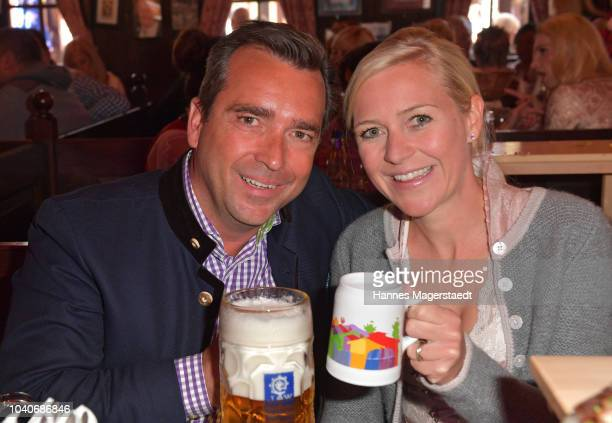 Andrea Muehlbauer and Falk Raudies during the charity lunch in favor of the Frohes Herz eV as part of the Oktoberfest 2018 at Zur Bratwurst tent at...