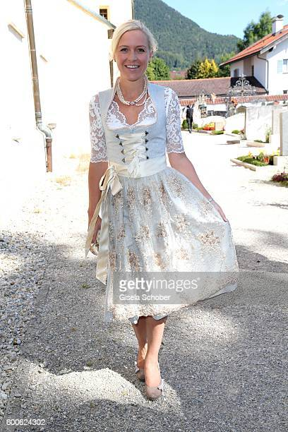 Andrea Muehlbauer former Arland wearing a dirndl during the wedding of Marianne and Michael Hartl at St Laurentius church on September 8 2016 in...