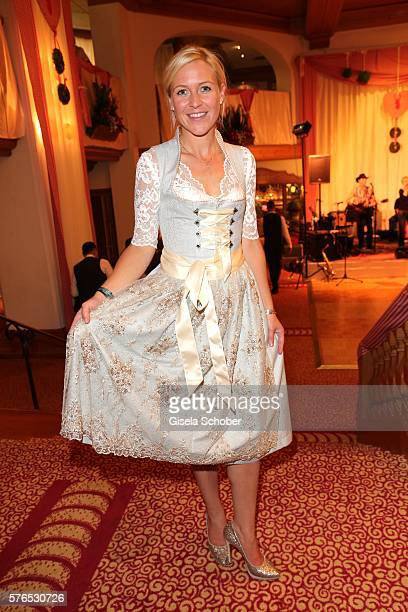 Andrea Muehlbauer formerly wife of Maxi Arland wearing a dirndl by Alpenmaedl during a bavarian evening ahead of the Kaiser Cup 2016 on July 15 2016...