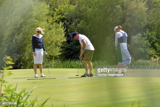 Andrea Muehlbauer her husband Falk Raudies and Sybille Beckenbauer during the 7 M M EAGLES Charity LEDERHOS'N Golf Cup 2018 at Golfclub Castle...