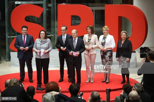 Andrea Nahles and Olaf Scholz of the German Social Democrats present their members of the next German government cabinet Hubertus Heil who is to...