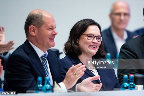 Andrea Nahles and Olaf Scholz smile at a federal party congress of the German Social Democrats following the election of Andrea Nahles as new party...