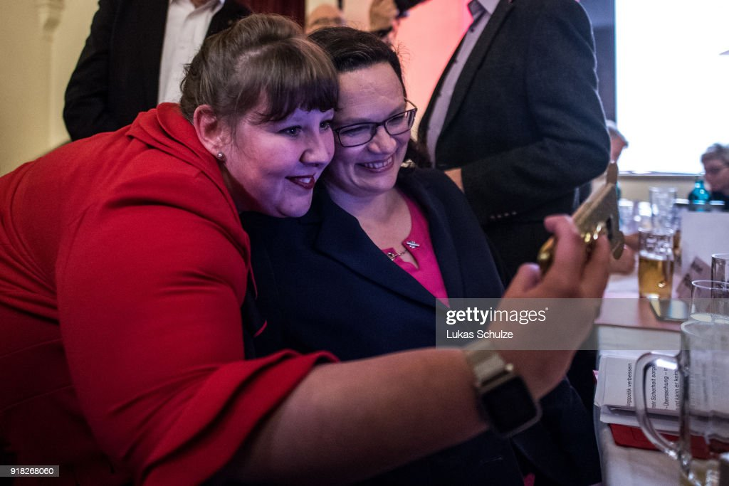 Andrea Nahles (R), Bundestag faction leader of the German Social Democrats (SPD), takes a selfie with members of the SPD during the local political Ash Wednesday SPD gathering on February 14, 2018 in Schwerte, Germany. Nahles is hoping to become party leader at a federal SPD congress on April 22 following yesterday's resignation of SPD leader Martin Schulz. The SPD is struggling through a disastrous last 12 months that have seen the party stymied by leadership mishaps and plummeting support in polls. The SPD leadership has committed itself to joining a government coalition with the German Christian Democrats (CDU/CSU), a move unpopular with a large swathe of its membership.