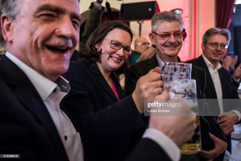 Andrea Nahles (L), Bundestag faction leader of the German Social Democrats (SPD), and Michael Groschek drink a beer during the local political Ash Wednesday SPD gathering on February 14, 2018 in Schwerte, Germany. Nahles is hoping to become party leader at a federal SPD congress on April 22 following yesterday's resignation of SPD leader Martin Schulz. The SPD is struggling through a disastrous last 12 months that have seen the party stymied by leadership mishaps and plummeting support in polls. The SPD leadership has committed itself to joining a government coalition with the German Christian Democrats (CDU/CSU), a move unpopular with a large swathe of its membership.
