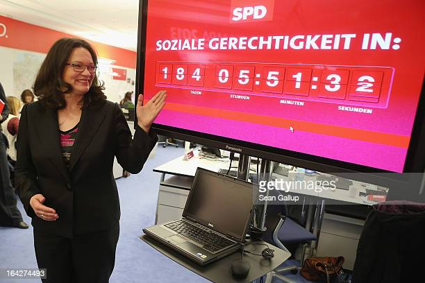 Andrea Nahles General Secretary of the German Social Democarts gestures to a clock counting down the time to German federal elections scheduled for...