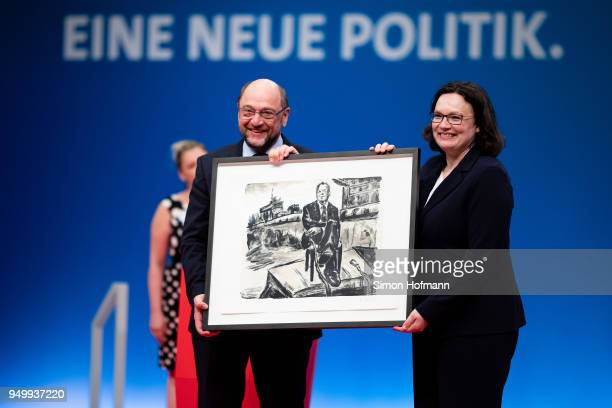 Andrea Nahles hands over a present to Martin Schulz at a federal party congress of the German Social Democrats following her election as new party...