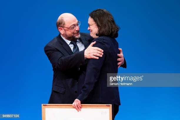 Andrea Nahles hugs Martin Schulz at a federal party congress of the German Social Democrats following her election as new party leader on April 22...