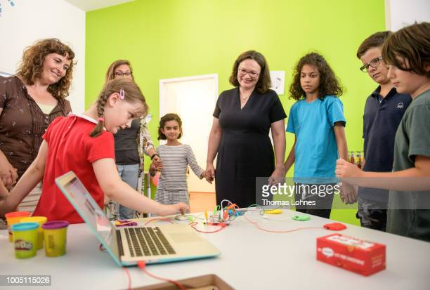 Andrea Nahles leader of the German Social Democrats and children play the piano with modeling clay and get so electronic skills at HABA...