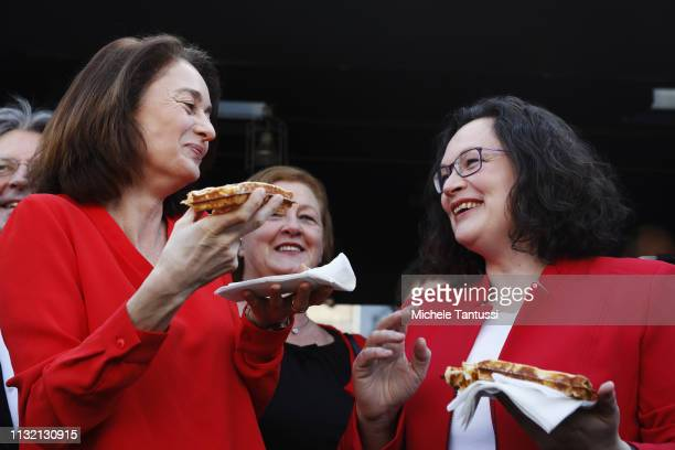 Andrea Nahles leader of the German Social Democrats and Justice Minister and candidate for the EU Elections Katarina Barley chat as they eat a waffle...