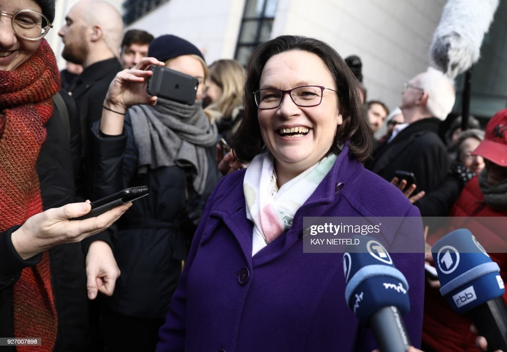 Andrea Nahles, parliamentary group leader of Germany's Social Democrats (SPD) party and also designated SPD leader, smiles as she gives a statement after the result was announced of the SPD party members' referendum on whether or not to join a new coalition government with German Chancellor Angela Merkel's conservatives, on March 4, 2018 at the SPD headquarters in Berlin. The members of Germany's second biggest party have in their high-stakes referendum approved a plan to join Chancellor Angela Merkel's coalition. The make or break vote was the last hurdle in the way of Merkel's fourth term in office and essentially ends a political stalemate that has plagued the country since September's inconclusive elections. / AFP PHOTO / DPA / Kay NIETFELD / Germany OUT