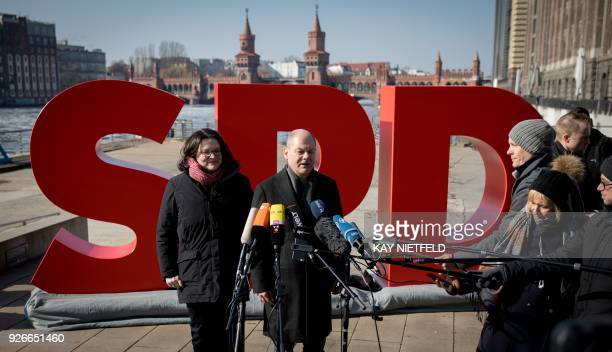 Andrea Nahles , parliamentary group leader of Germany's social democratic SPD party, and Hamburg's mayor and interim SPD leader Olaf Scholz stand in...