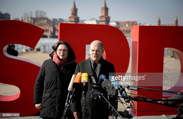 Andrea Nahles parliamentary group leader of Germany's social democratic SPD party and Hamburg's mayor and interim SPD leader Olaf Scholz stand in...