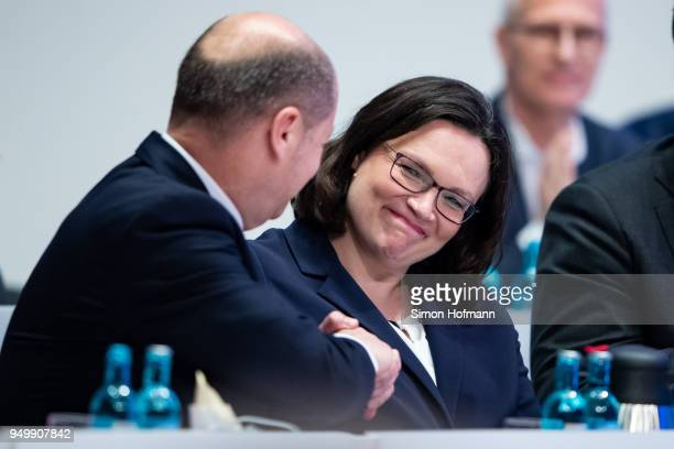 Andrea Nahles shakes hands with Olaf Scholz at a federal party congress of the German Social Democrats following her election as new party leader on...