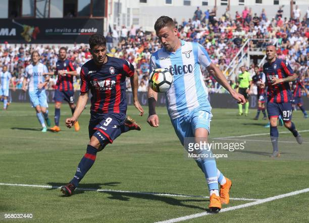 Andrea Nalini of Crotone competes for the ball with Sergej Milinkovic Savic of Lazio during the serie A match between FC Crotone and SS Lazio at...