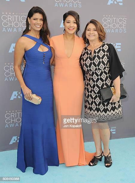 Andrea Navedo Gina Rodriguez and mom Magali Rodriguez arrive at The 21st Annual Critics' Choice Awards at Barker Hangar on January 17 2016 in Santa...
