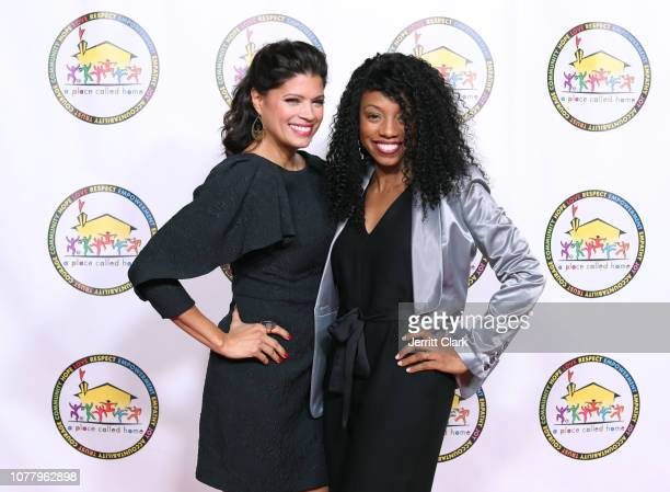 Andrea Navedo poses with a guest at A Place Called Home's 18th Annual Gala For The Children at The Beverly Hilton Hotel on December 05 2018 in...