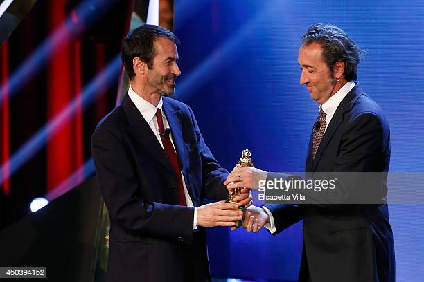 Andrea Occhipinti receives the best European Union film award for 'Philomena' from Paolo Sorrentino as he attends the David Di Donatello Awards...