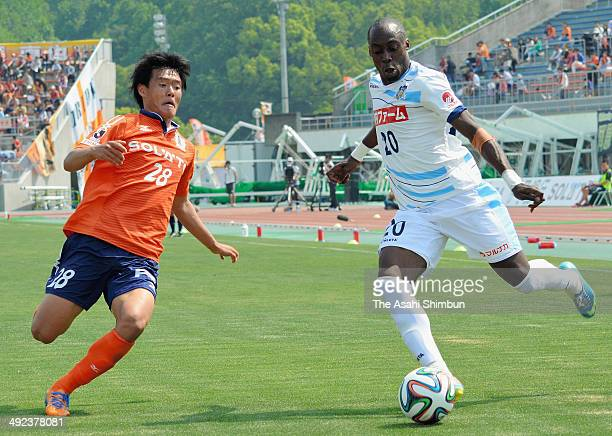 Andrea of Kamatamare Sanuki and Han HeeHoon of Ehime FC compete for the ball during the JLeague second division match between Ehime FC and Kamatamare...