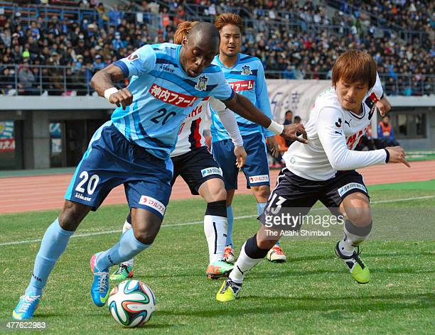 Andrea of Kamatamare Sanuki and Tomohiko Miyazaki of Jubilo Iwata compete for the ball during the JLeague second division match between Kamatamare...